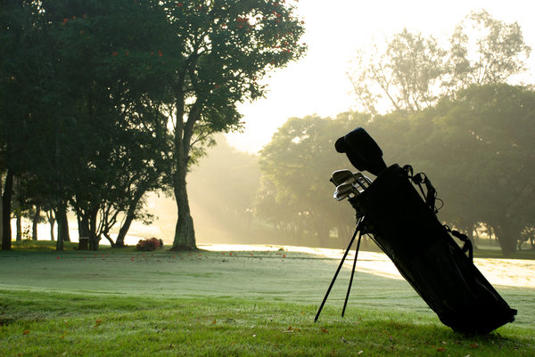 Golf bag at sunset